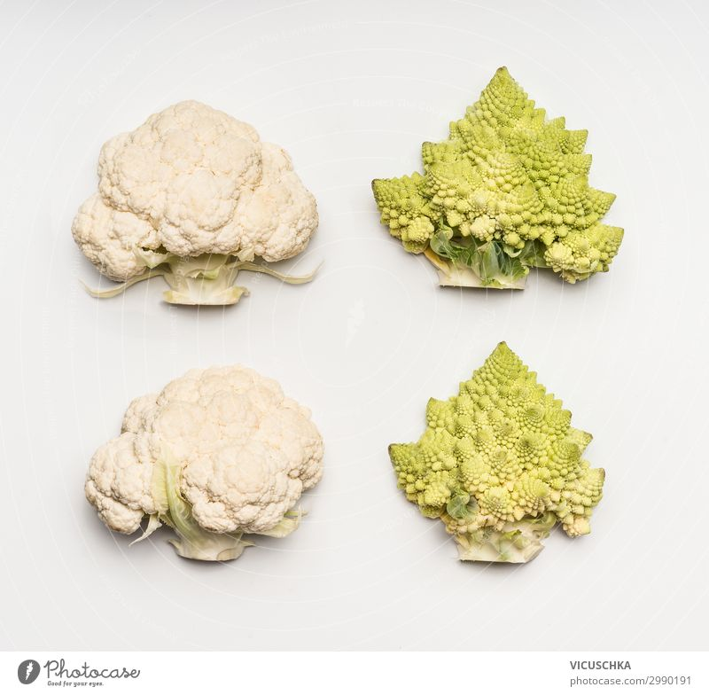 Cauliflower and Romanesco cabbage on white background Food Vegetable Nutrition Lifestyle Style Design Healthy Eating Vitamin Broccoli Half Bright background
