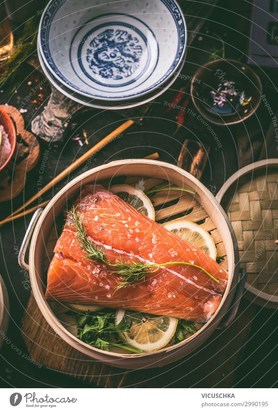 Salmon fillet in asian bamboo steamer pot Food Fish Herbs and spices Nutrition Lunch Organic produce Vegetarian diet Diet Asian Food Crockery Style Design