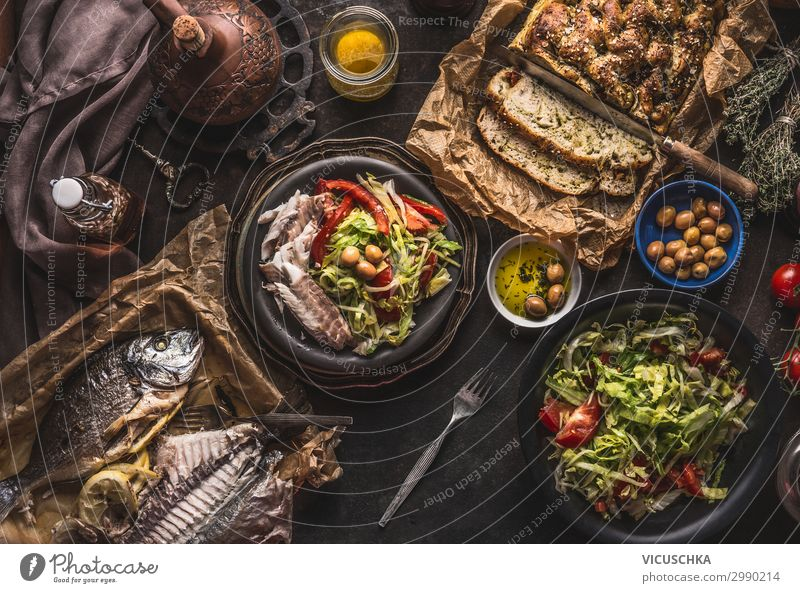 Mediterranean dinner with fried fish Food Fish Nutrition Banquet Crockery Style Design Living or residing Table Restaurant homemade bread olive oil Dorade above