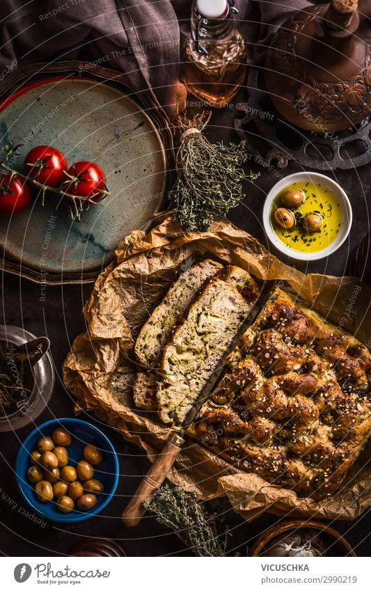 Focaccia bread with knife and olive oil Food Bread Herbs and spices Cooking oil Nutrition Lunch Italian Food Crockery Design Living or residing Restaurant Snack