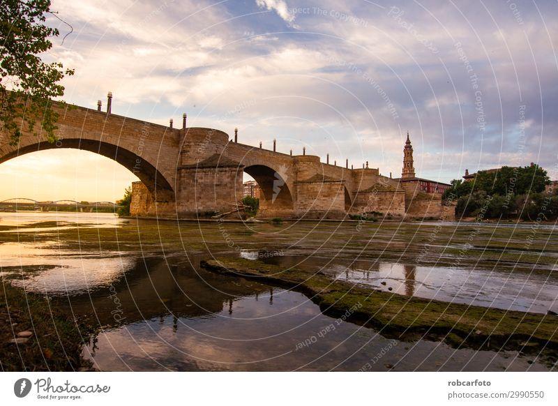 Ebro river passing through Zaragoza Vacation & Travel Tourism Culture Landscape Sky River Church Places Bridge Building Architecture Monument Stone Old Historic