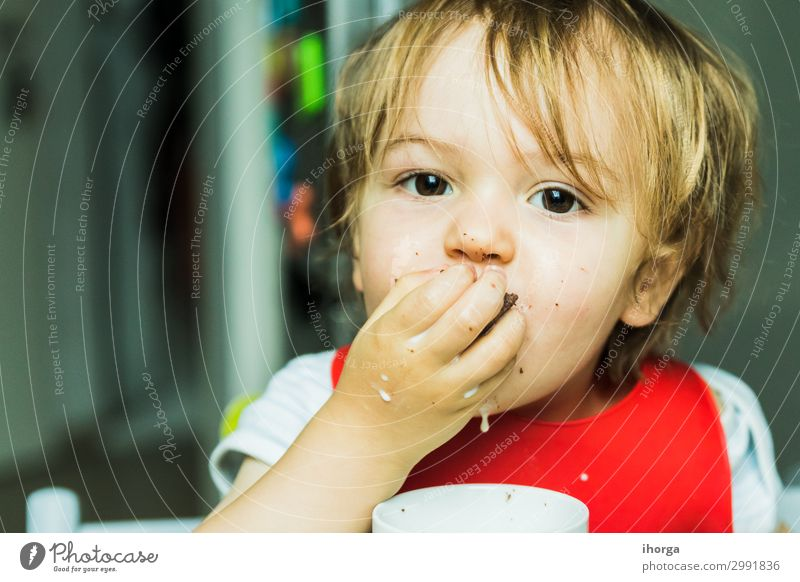 portrait adorable child eating chocolate sponge cake Chocolate Eating Milk Child Baby Boy (child) Infancy Face Hand 1 Human being 1 - 3 years Toddler Smiling