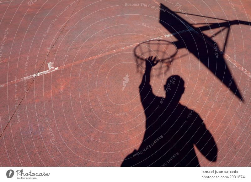 man playing basketball shadow silhouette in the street Basketball Shadow Silhouette Sunlight Ground Playing field Story Sports Abandon Street Park Playground
