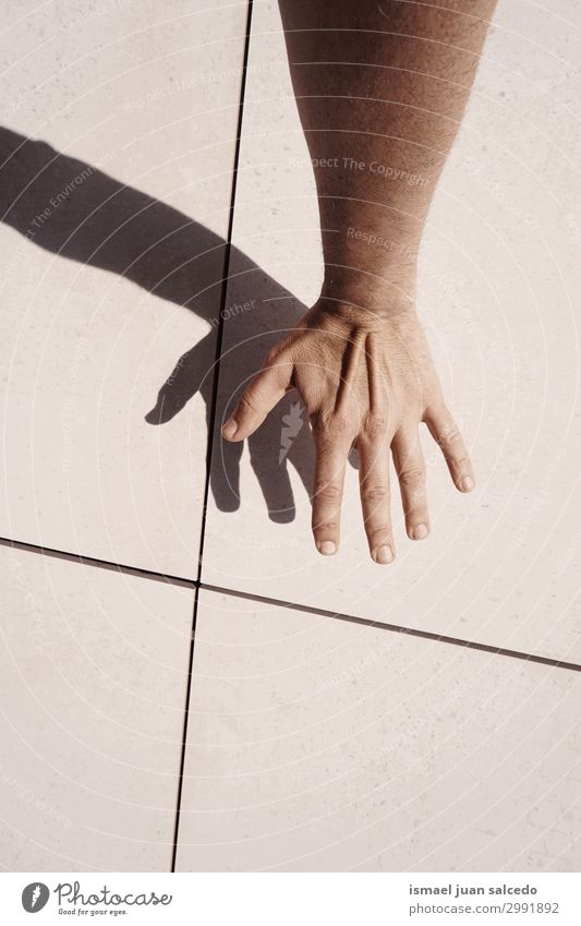 man hand shadow silhouette on the wall in the street Human being Hand Street Skin Arm Fingers Symbols and metaphors Conceptual design Minimalistic Gesture