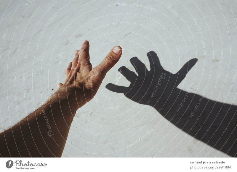 man hand shadow silhouette on the wall Human being Hand Street Skin Arm Fingers Symbols and metaphors Conceptual design Minimalistic Gesture Palm of the hand