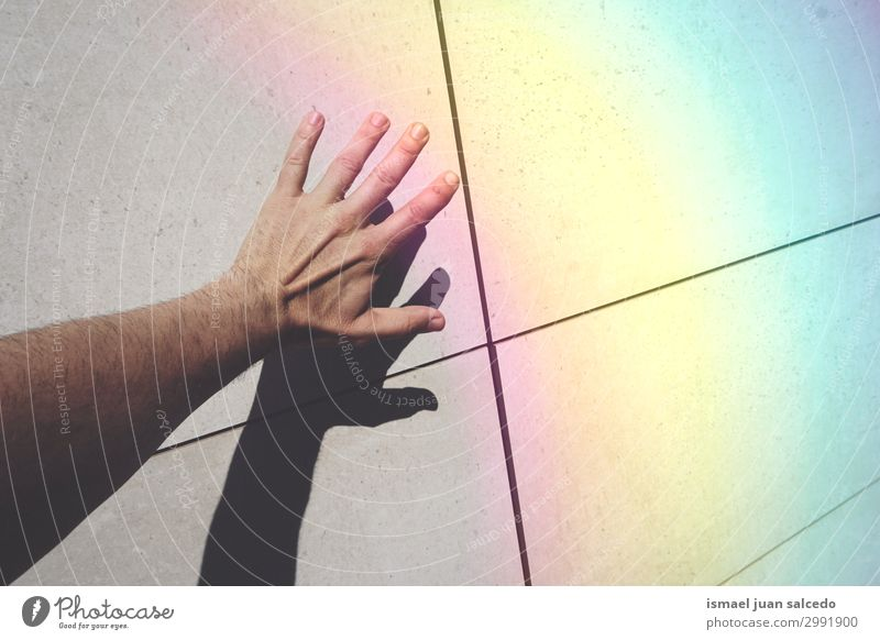 man hand shadow shilhouette and rainbow on the wall Human being Hand Street Skin Arm Fingers Symbols and metaphors Rainbow Conceptual design Minimalistic