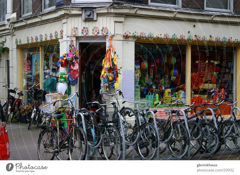 fietsers Amsterdam Netherlands Shop window Multicoloured Old building Bike Rental Shop Bicycle rack Europe bicycle shop bike shop orange Elftal Decoration