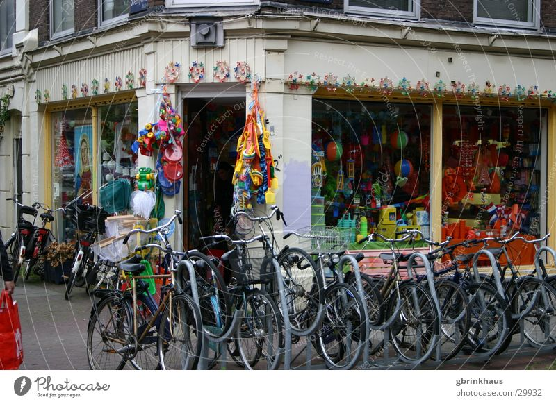 Orange Europe Decoration Store premises Netherlands Old building Amsterdam Shop window Bicycle rack Bike Rental Shop