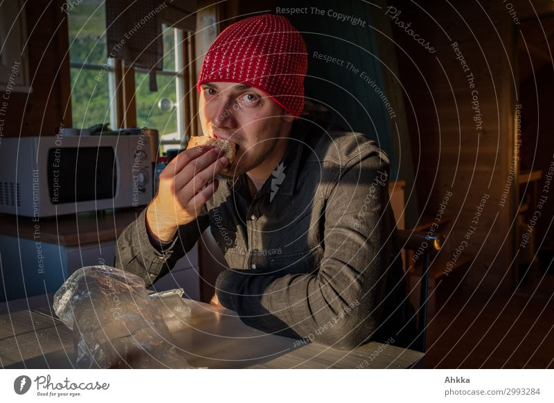 sandwich for the break Bread Nutrition Eating Slow food Finger food Flat (apartment) Young man Youth (Young adults) Sunlight Hut Shirt Cap Natural Break