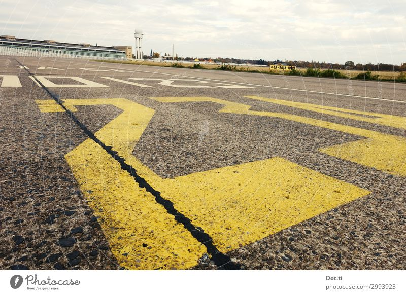 THF Clouds Capital city Deserted Places Airport Yellow Far-off places tempelhofer field Airport Berlin-Tempelhof Runway Characters Digits and numbers Concrete