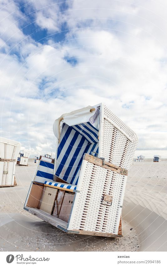 White beach chair with blue stripes on beach under clouds in nice weather Vacation & Travel Tourism Summer Summer vacation Sunbathing Beach Landscape Sky Clouds