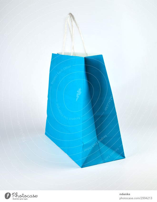blue paper shopping bag with a handle Blue Colour White Lifestyle Style Business Fashion Design Modern Stand Gift Shopping Paper New Packaging Storage