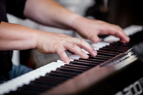 Play it again, Sam. Lifestyle Music Feasts & Celebrations Wedding Parenting Education Adult Education Music tuition Musician Masculine Man Adults Hand Fingers 1