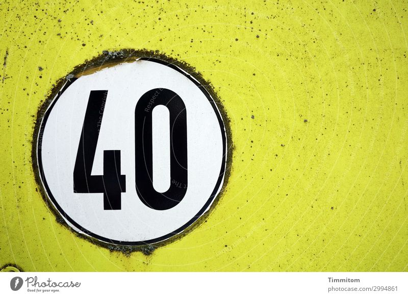 40 Vehicle Utility vehicle Metal Plastic Digits and numbers Old Simple Yellow Black White Emotions Label Round speed sticker Abrasion Colour photo Exterior shot