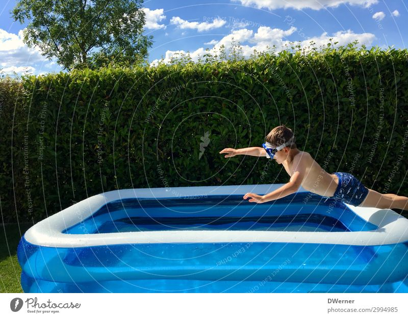 Superman Leisure and hobbies Summer Summer vacation Sunbathing Swimming pool Boy (child) Sunlight Beautiful weather Garden Swimming trunks Water Jump Romp