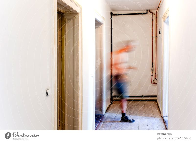 Man from left to right Old building Wooden board Hallway Wooden floor Floor covering Wall (barrier) Human being Room Interior design Copy Space Blur
