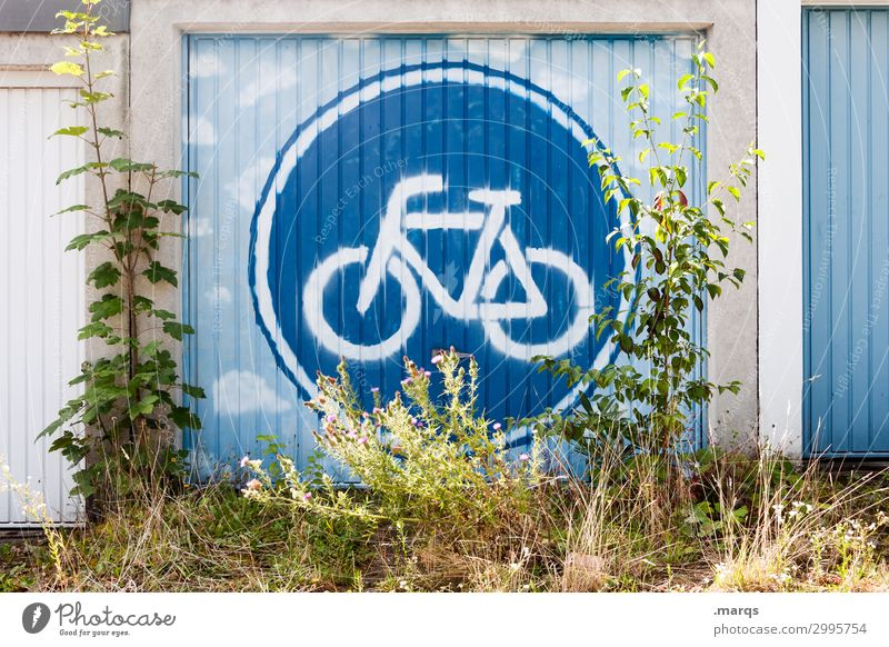 Bicycle friendly Nature Bushes Garage Garage door Signs and labeling Road sign Graffiti Sustainability Environmental protection CO2 emission Colour photo