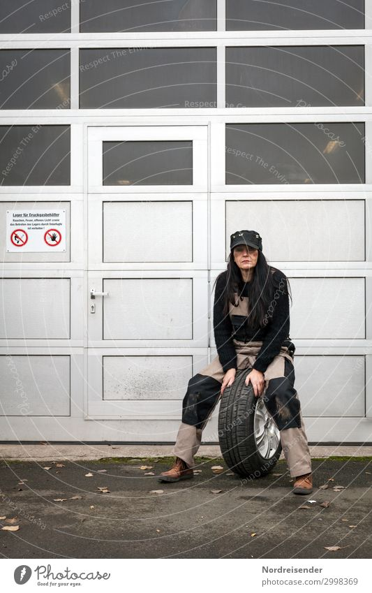 tyre change Work and employment Workplace Craftsperson Profession Economy Logistics Services Craft (trade) SME Human being Woman Feminine Adults Workwear cap