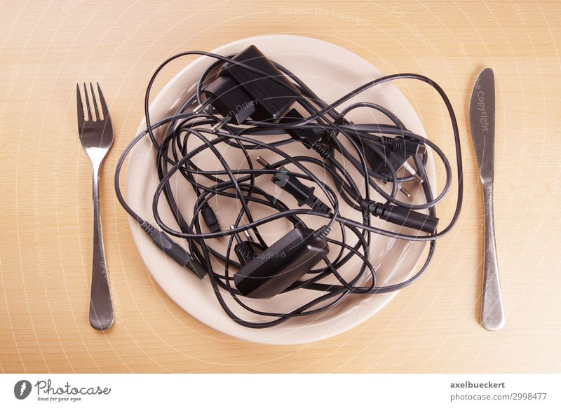 tangled cables Table Funny Chaos Whimsical Surrealism Humor Terminal connector Cable charger cable Plate Cutlery Technology Aggravation Eating Diet Muddled Knot
