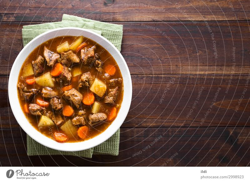 Beef Stew Meat Vegetable Soup Bowl Fresh food Carrot Potatoes Cooking Goulash Home-made Meal Dish paprika Hungarian gulyas gulyasleves diced served Copy Space