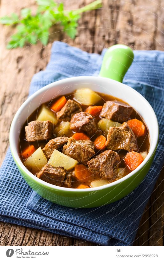 Beef Stew Meat Vegetable Soup Fresh food Carrot Potatoes Cooking Goulash Home-made Meal Dish paprika Hungarian gulyas gulyasleves diced served Vertical red bowl