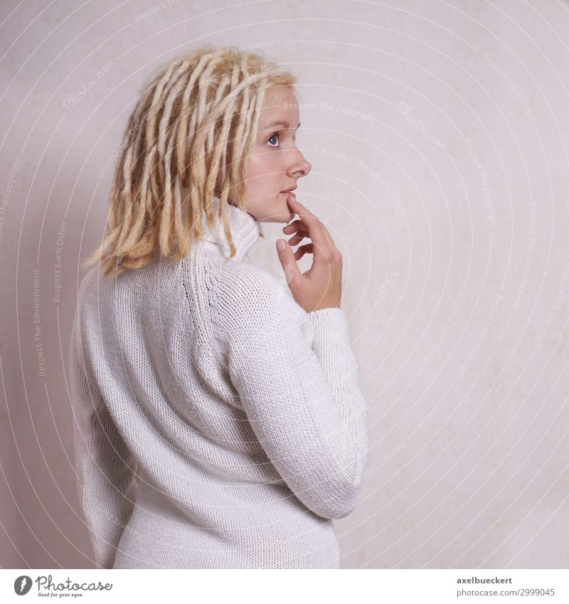 thoughtful woman with blond dreadlocks Lifestyle Human being Feminine Young woman Youth (Young adults) Woman Adults 1 18 - 30 years Subculture Sweater
