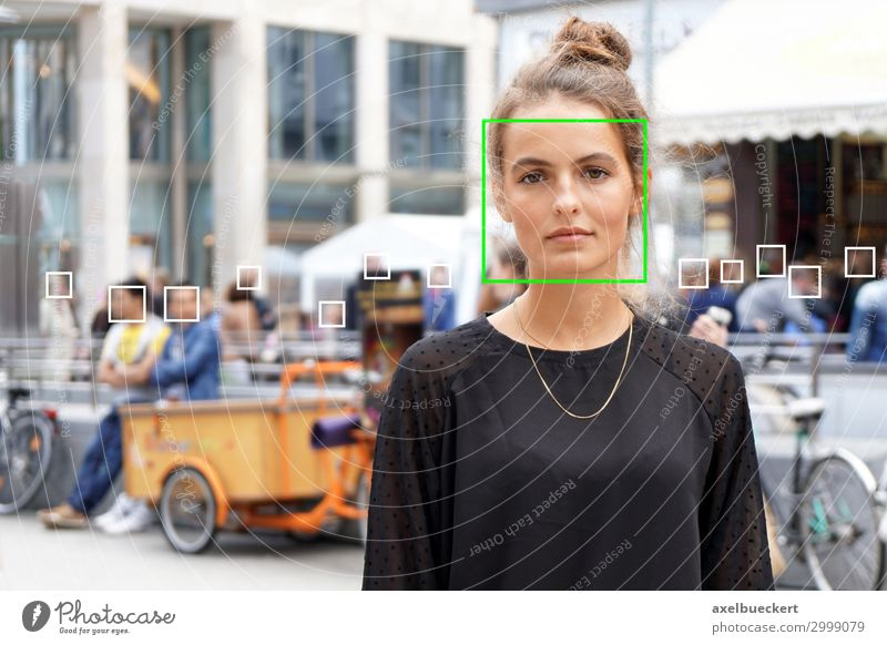 Face recognition of young woman in the crowd face recognition Artificial intelligence Surveillance Technology Software Science & Research Advancement Future