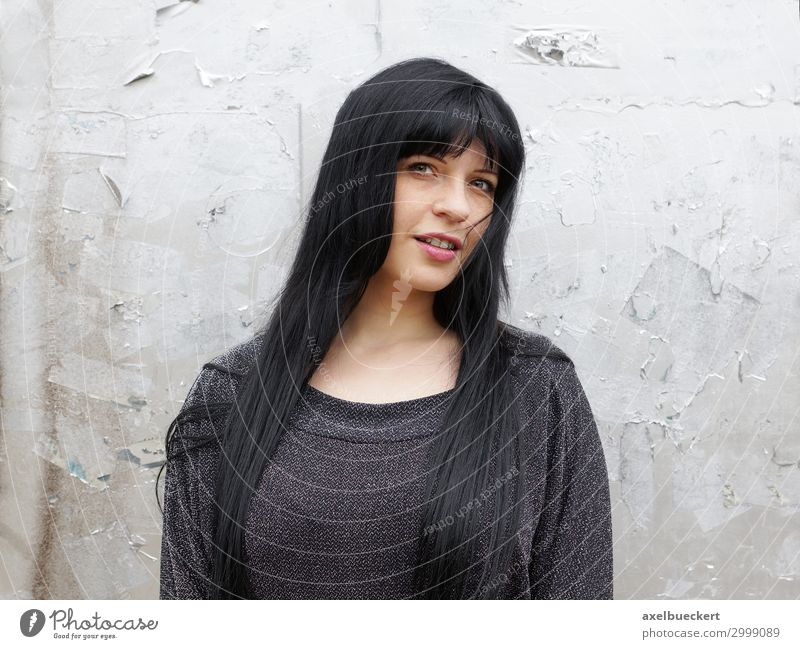 young woman with long black hair Lifestyle Human being Feminine Young woman Youth (Young adults) Woman Adults 1 18 - 30 years Wall (barrier) Wall (building)