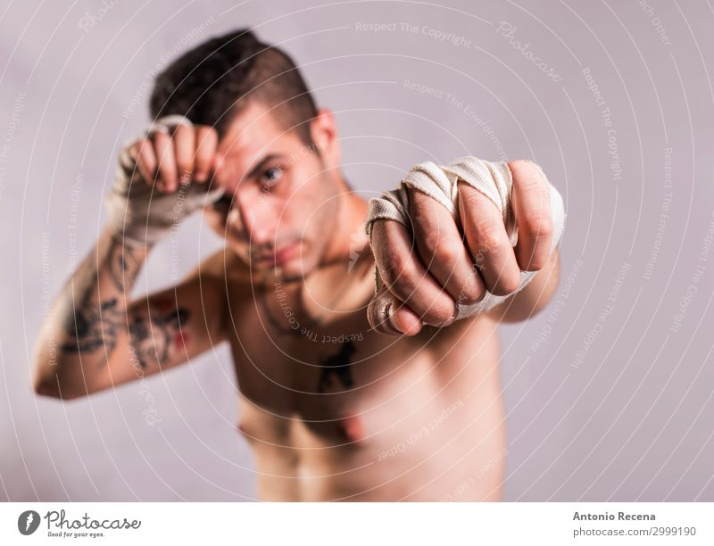 Muai thai fighter posing in studio shot with tattoos Sports Boy (child) Man Adults Ring Tattoo Gloves Fitness Aggression Strong Anger Power Protection Force