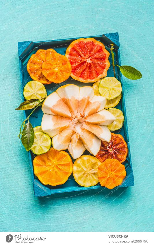 Various colorful citrus fruits with green leaves . Food Fruit Orange Nutrition Organic produce Diet Juice Lifestyle Style Healthy Eating Yellow Design