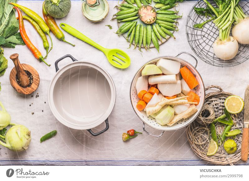 Selection of seasonal vegetables on the kitchen table Food Vegetable Soup Stew Herbs and spices Nutrition Organic produce Vegetarian diet Diet Crockery Pot