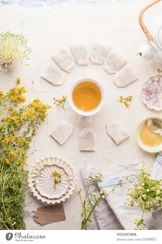 Cup of herbal tea with frame of tea bags Food Herbs and spices Organic produce Beverage Hot drink Tea Crockery Style Healthy Healthy Eating Plant Yellow White