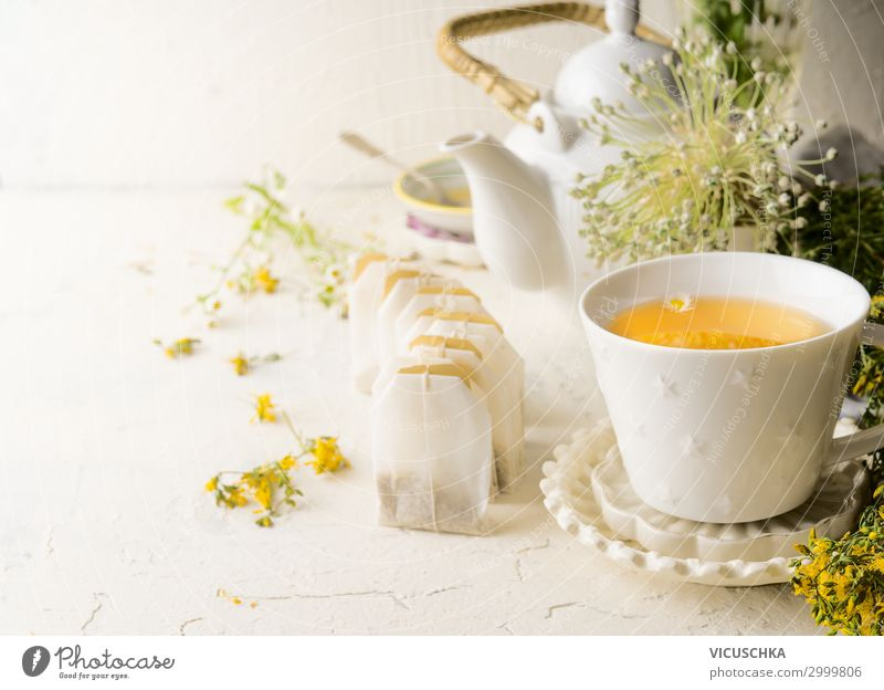 Tea cup with herbal tea tea bags Food Nutrition Breakfast Beverage Hot drink Style Design Healthy Eating Living or residing Blossom Yellow Health care