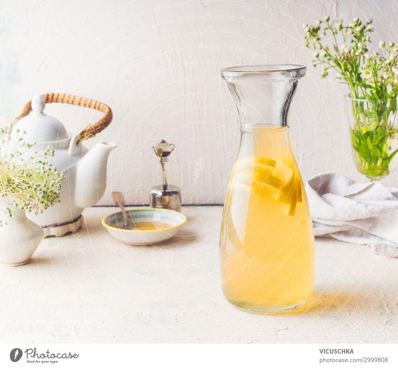 Carafe with white tea lemon lemonade Beverage Cold drink Drinking water Lemonade Juice Style Healthy Eating Summer Living or residing Cool (slang) Yellow Design