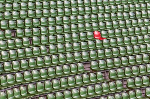 Insulation | In the stadium green rows of seats with a red seat Chair Event Sports Audience Fan Stands Sporting event Sporting Complex Stadium Exceptional Canoe