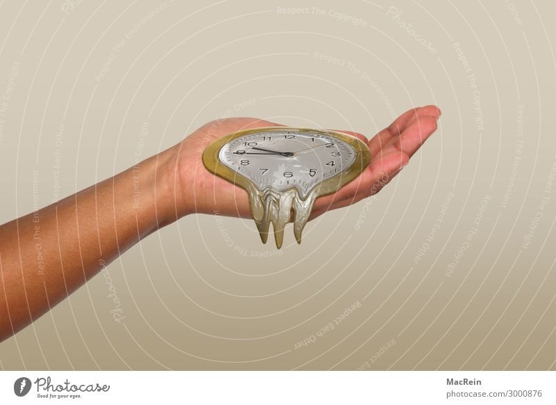 Time is running out Human being Hand Art Sign Yellow Gold Women`s hand Symbols and metaphors Haste Melt away Clock Palm of the hand Colour photo Interior shot