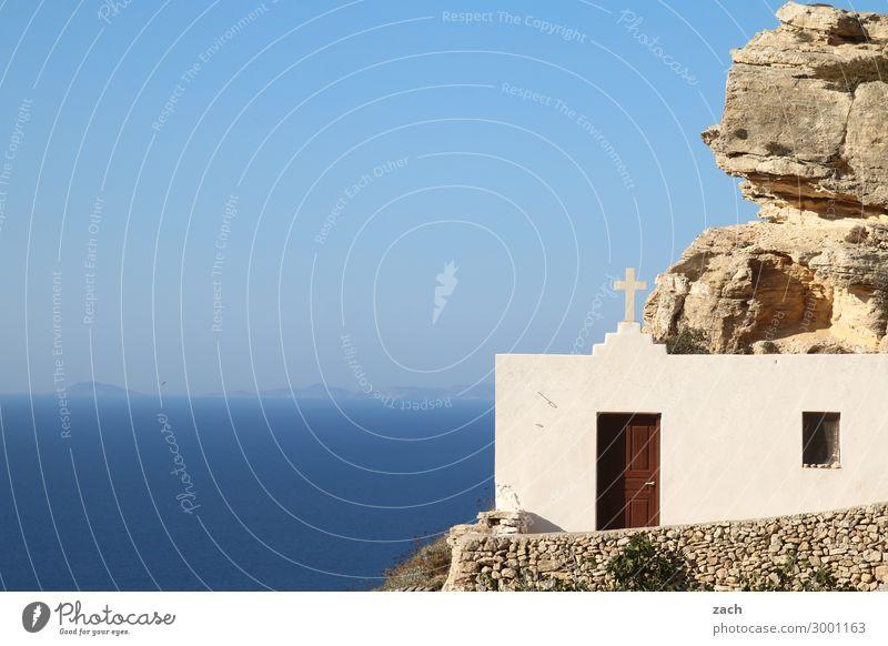Sky Blue Water White Landscape Ocean Religion and faith Coast Facade Rock Horizon Door Church Island Belief Crucifix
