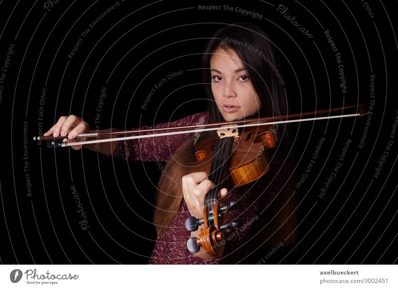 young Asian plays violin Lifestyle Leisure and hobbies Music Human being Feminine Young woman Youth (Young adults) Woman Adults 1 13 - 18 years 18 - 30 years