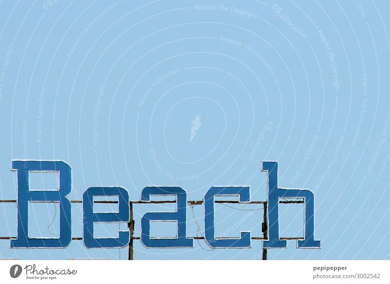 beach Vacation & Travel Tourism Summer Summer vacation Beach Sky Cloudless sky Waves Coast Ocean Steel Rust Plastic Characters Signs and labeling Line Blue