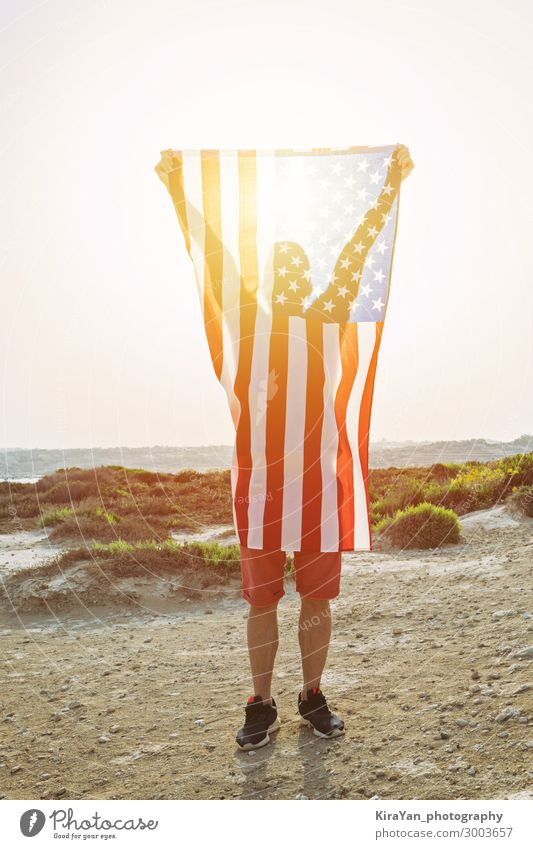 Silhouette of man with American Flag Vacation & Travel Man Joy Lifestyle Adults Feasts & Celebrations Freedom Stand Happiness Authentic USA Stripe Pride