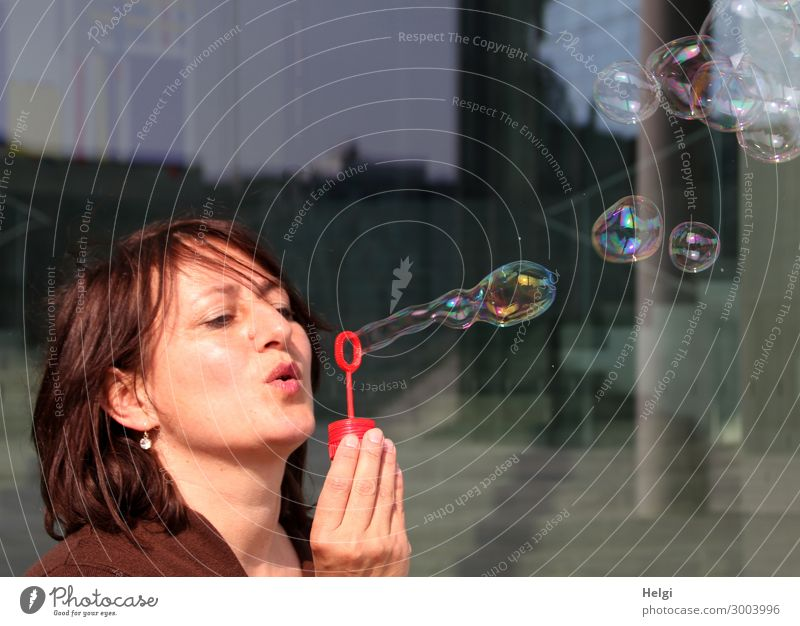 Woman with brunette long hair blows bubbles Human being Feminine Adults Head Hair and hairstyles Hand Fingers 1 45 - 60 years Soap bubble To hold on Exceptional