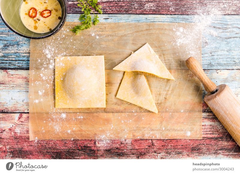 Homemade tortelloni on a colourful wooden table Food Dough Baked goods Nutrition Lunch Dinner Banquet Slow food Italian Food Feasts & Celebrations Delicious