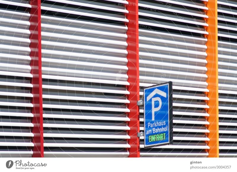 Modern multi-storey car park Design Parking garage Building Architecture Facade Sign Signs and labeling Road sign New Multicoloured Symmetry