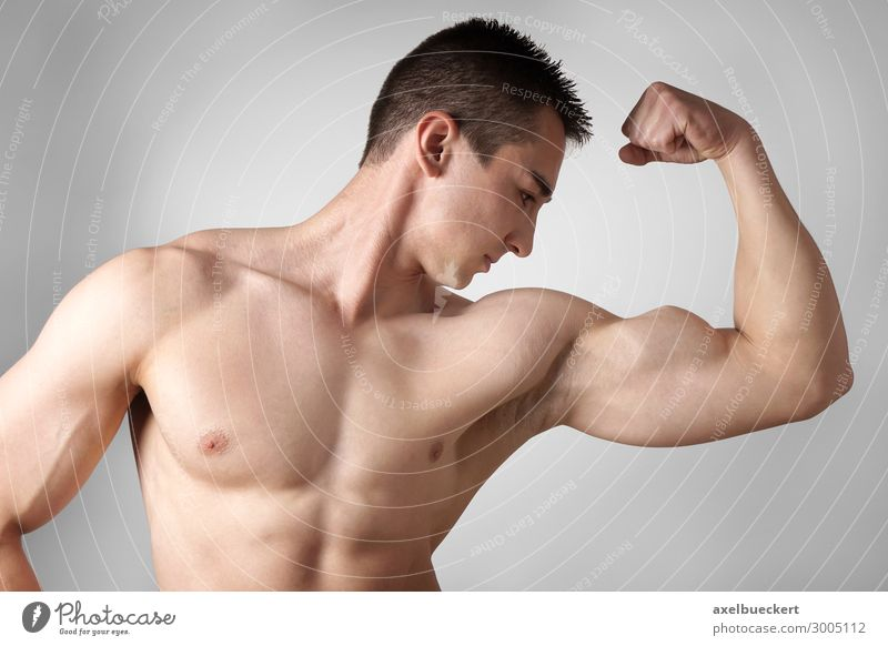 Bodybuilder shows bicep muscles Lifestyle Healthy Athletic Fitness Leisure and hobbies Sports Training Success Human being Masculine Young man