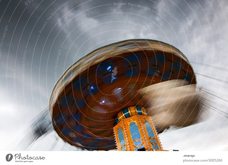 funfair Oktoberfest Fairs & Carnivals Storm clouds Chairoplane Rotate Speed Joy Happiness Vertigo Colour photo Exterior shot Deserted Copy Space left