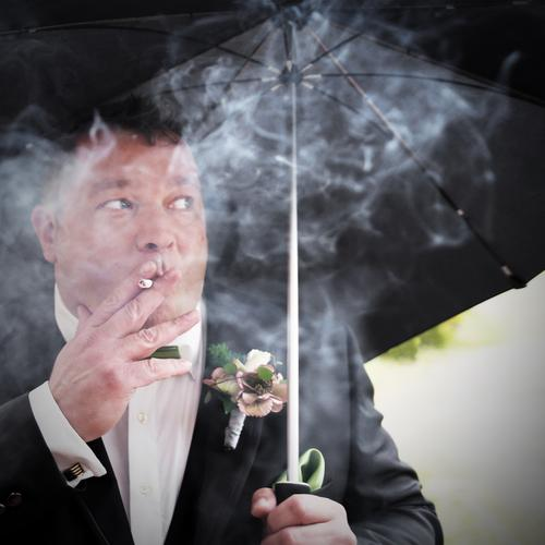 10 minutes left to say YES Masculine Man Adults Human being Flower Suit Jewellery Umbrella Brunette Short-haired Observe Smoking Looking Passion Safety