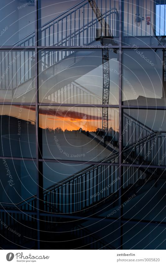 Stairs with sunset Facade Window Glazed facade Glas facade Glass Mirror image Reflection Staircase (Hallway) Landing Descent Go up Handrail Banister Deserted