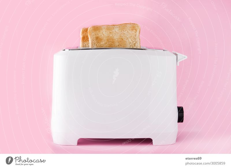 "Toasted toast bread in toaster on pink background Food Bread Nutrition Breakfast Dinner Organic produce Vegetarian diet Fast food Good ""toast ready white"
