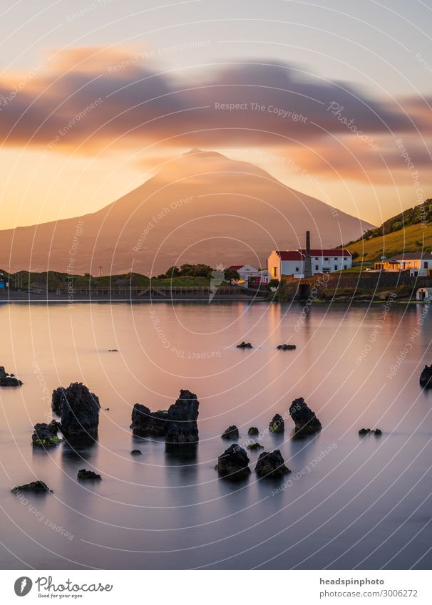 Volcano island Pico, Azores and the Atlantic Ocean at sunrise Vacation & Travel Tourism Far-off places Sightseeing Cruise Landscape Elements Clouds Coast