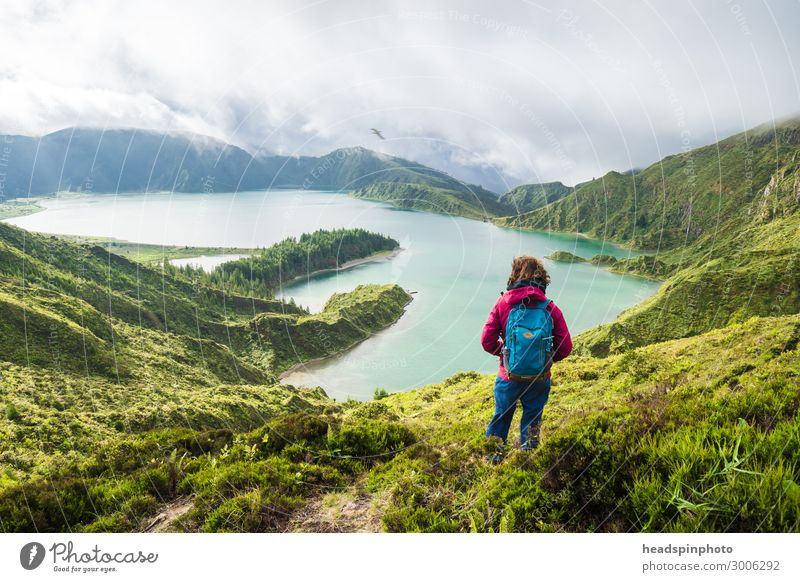 Young woman with rucksack in front of a mountain lake in the Azores Joy Happy Vacation & Travel Tourism Trip Adventure Far-off places Freedom Expedition Island